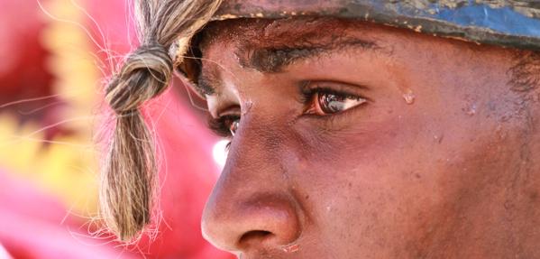 Man wearing a mask at Carnival in Jacmel, Haiti
