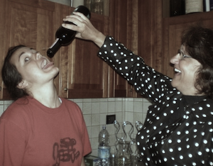 Mom feeding me the last drops of wine