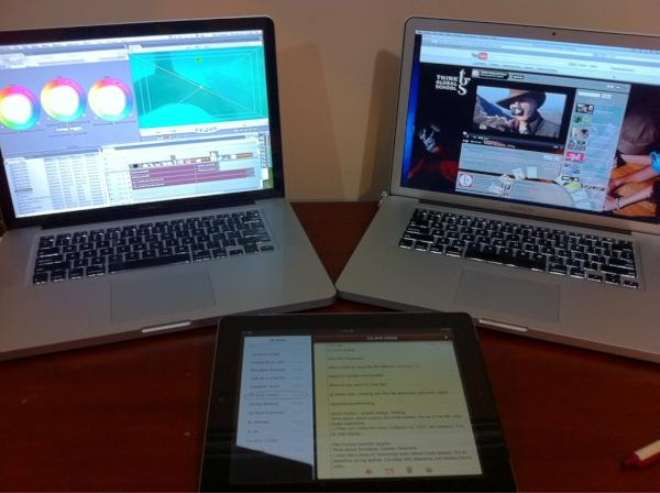 My Ecuador desk with laptops, iPad, iPhone