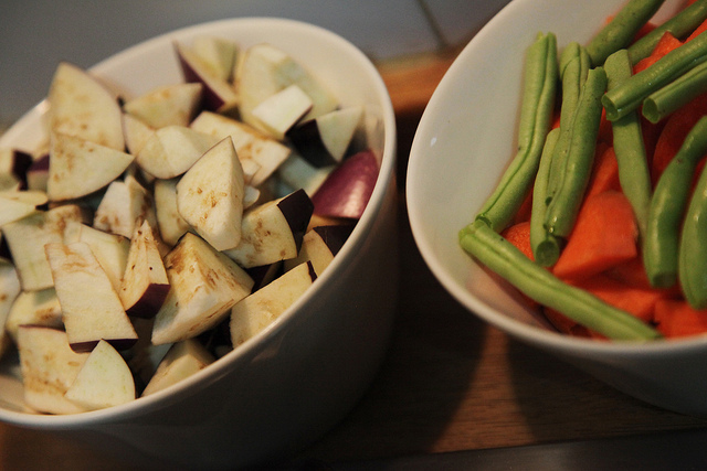 Chopped eggplant, long green beans, and carrots while cooking in Thailand
