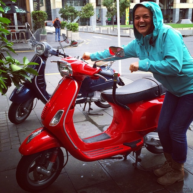 Lindsay on a moped in Auckland, New Zealand