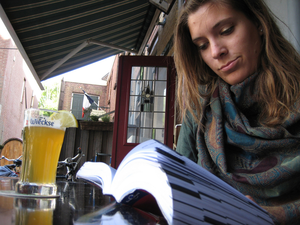Alexis reads her guidebook from a bar in Delft, Holland