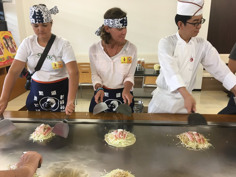 Practicing the art of okonomiyaki at the Otafuku factory