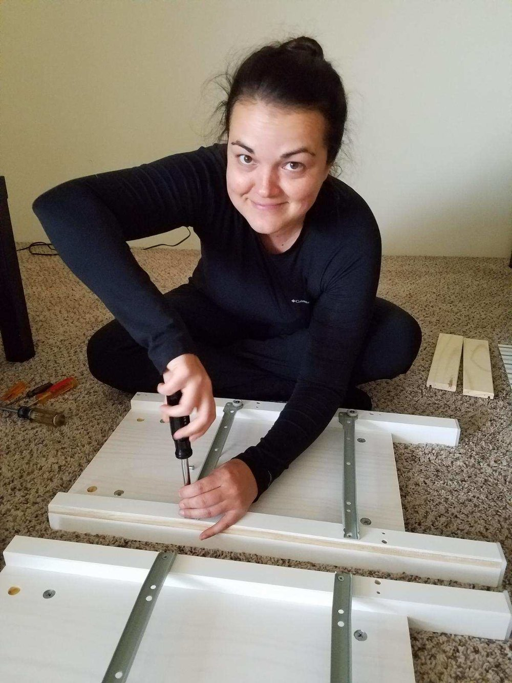 Lindsay fixing her nightstands from IKEA at new apartment in Denver