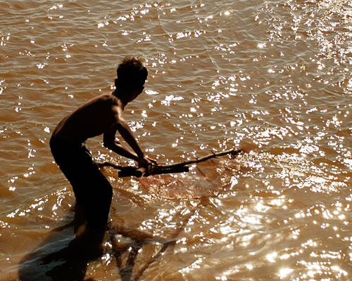 Alicia Morga Cambodia boy fishing