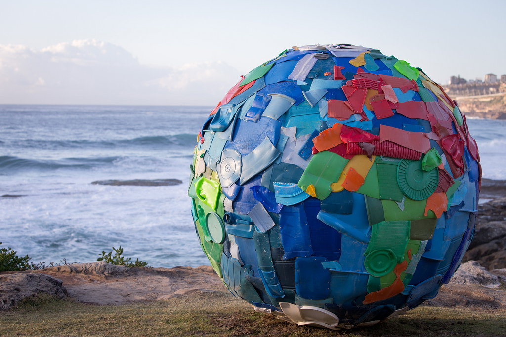 "unconsumption :      Plastic debris washed up on beaches gets turned into beachfront art:     ""Plastic World"" — made by Portuguese artists Carole Purnelle and  Nuno Maya  — pictured in Australia, on the Bondi to Tamarama coastal walk, during the 2013  Sculpture by the Sea, Bondi  exhibition.    The spherical sculpture is 79"" (200 cm) in diameter, in case you're wondering.   (photo credit:  Halans  on Flickr)     Auto-reblog: Because every day is Earth day.   Also, there are some really cool pieces associated with Sculpture by the Sea in Australia (link above).    Also:  This ."