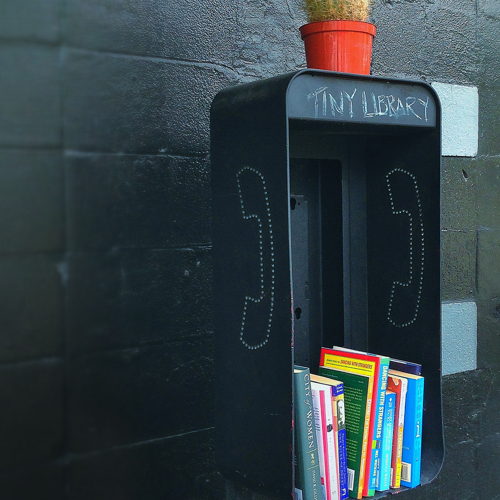 "unconsumption :    Pay phone booth repurposed as a tiny library — a ""take a book, leave a book"" little library.    I LOVE THIS — a creative reuse and community win!   This micro-library sits in Houston, Texas, outside local coffee house Black Hole — with a laundromat next door — near the University of St. Thomas and Houston's Museum District.   (photo by me, Houston-based Unconsumptioneer,  mollyblock )    Earlier Unconsumption posts on creative new uses for pay phones and phone booths can be found  here , and library-related items  here .       Bookshelf of the week , hands down."