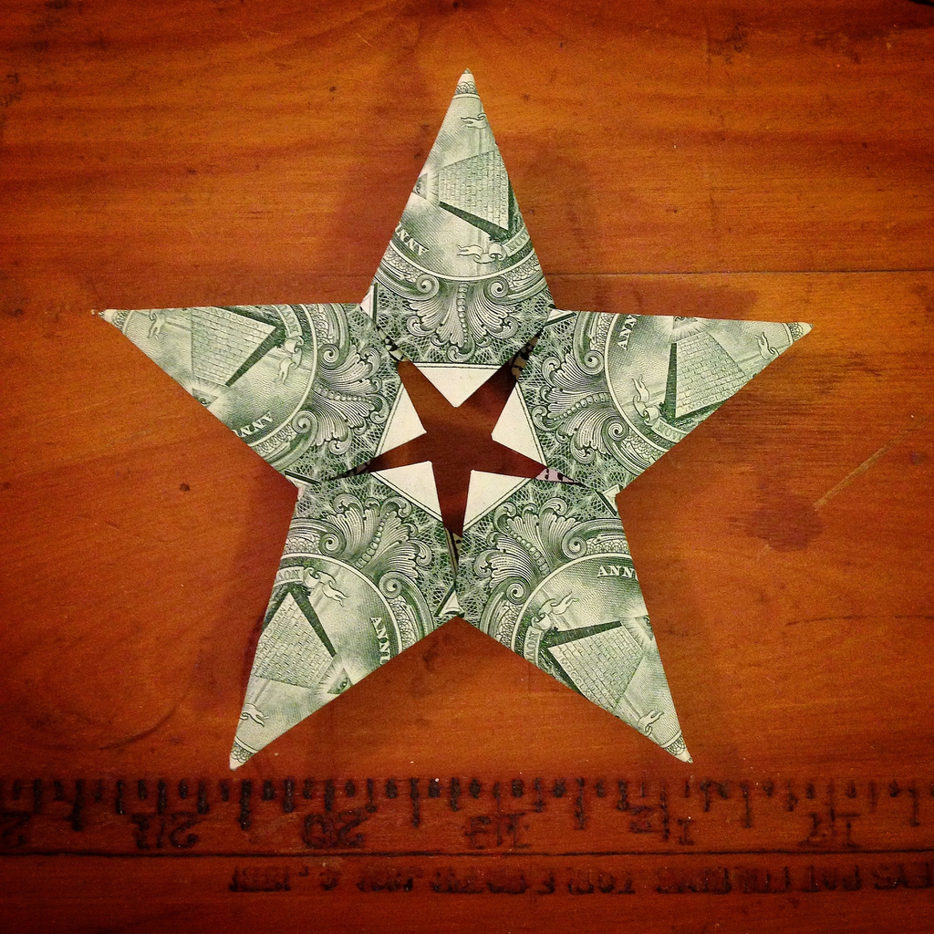 If you're going to give someone cash as a gift, here's a creative twist: Fold the currency into some interesting shape(s).     To make this star:    I ( mollyblock ) used  this tutorial  – posted on YouTube by Sweetfire Creations – as a guide for folding bills into a neat star shape that looks pretty good from either side. You can see the other side of my star  here .   All that's needed are five bills – the crisper, the better – and a little time and patience.   In case you're wondering: These stars do look nice hanging as ornaments!   (If you're a fan of altered currency origami and/or art, find other examples  here .)