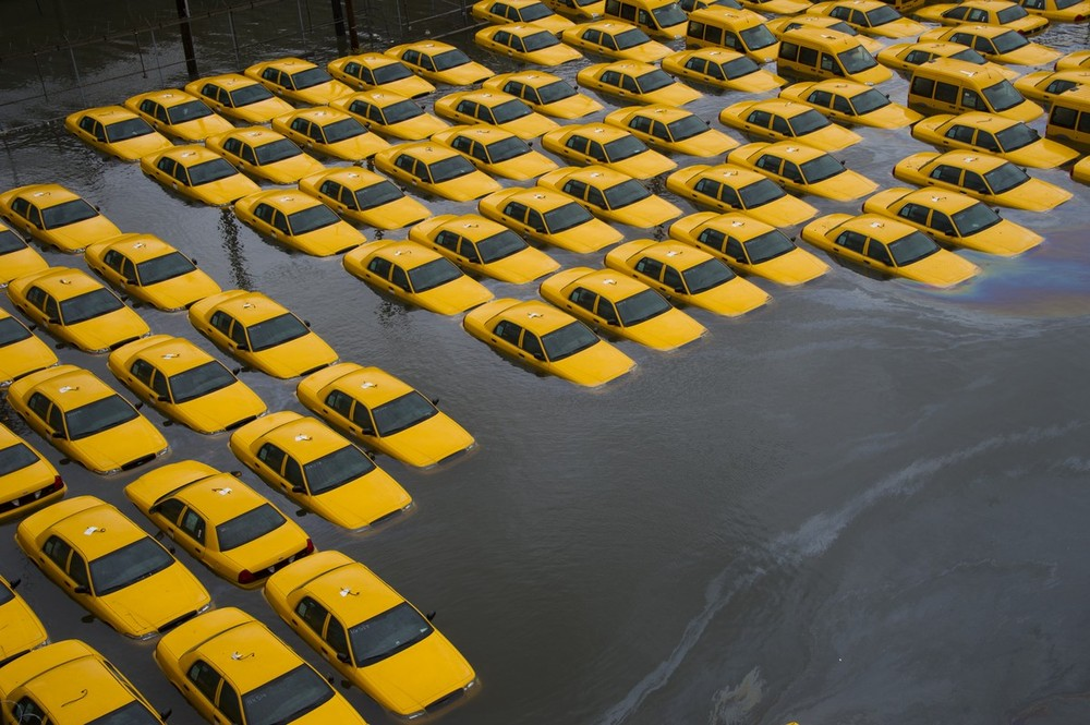 buzzfeedandrew :      A parking lot full of yellow cabs is flooded as a result of Hurricane Sandy in Hoboken. (AP)      Yikes. Just yikes.   [Another AP cab shot and other AP photos (and story)  here .]