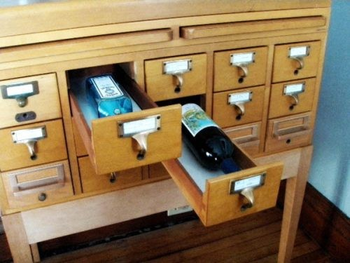 "unconsumption: To add to our posts about libraries, other book-related matters, and wine-related repurposing, there's this: An obsolete card catalog repurposed as a minibar. Need we say more?! (photo via The Sugar Monster on Flickr) Today, in ""things I love."""