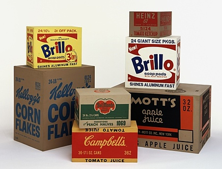 Andy Warhol,  Yellow Brillo Box , 1964;  White Brillo Box , 1964;  Mott's Apple Juice Box , 1964;  Heinz Tomato Ketchup Box , 1964;  Del Monte Peach Halves Box , 1964;  Campbell's Tomato Juice Box , 1964;  Kellogg's Corn Flakes Box , 1964.    Plywood boxes, painted and silk-screened with consumer product logos.      (via  Walker Art Center )