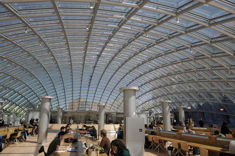 theatlantic: An $81 million library opened Monday at the University of Chicago. And there's not a book in sight. Designed by architect Helmut Jahn, the Joe and Rika Mansueto Library provides 180 seats for students and faculty to study under a glass dome constructed from 691 panels, none of them exactly the same shape. The library also expands digitization and conservation operations for the university's collections, which include a piece of a Gutenberg Bible and books printed on papyrus, ancient Egypt's version of paper. Fifty feet below ground on the Hyde Park campus, a system of five automated cranes retrieves and stores volumes that are sorted according to book size, not content. The new library has room for 3.5 million volumes in the underground area, which is not accessible to anyone but select library staff. Check out this incredible video on how the University of Chicago's automated library works.