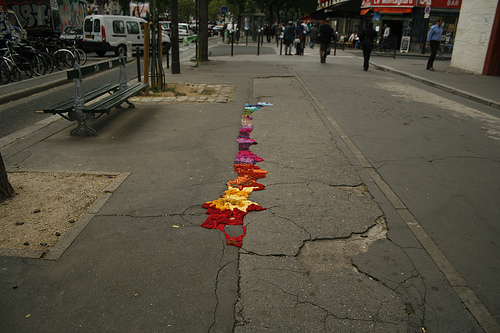 Juliana Santacruz Herrera uses yarn to fill in potholes and cracks in Paris's roads and walkways. Check out her work  here  on Flickr.   (via  Apartment Therapy Re-Nest )   See also earlier Everything Matters post  here  about pothole-inspired art, and Gardens in Unexpected Places post  here  about pothole gardening.