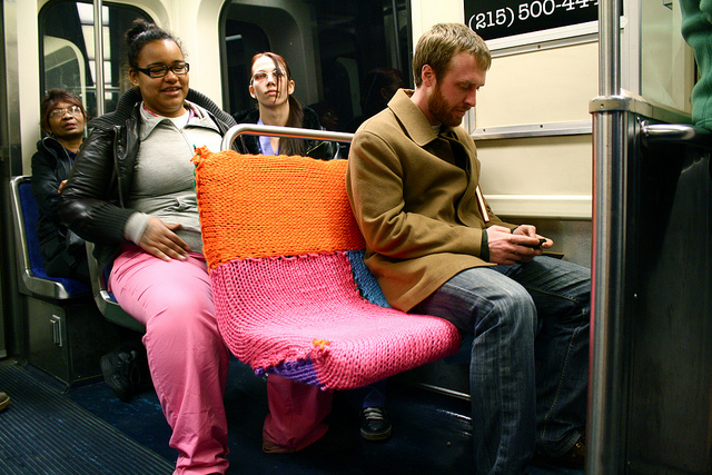 newsweek :      laughingsquid :      Ishknits Yarn Bomber Strikes Philadelphia Train      We love guerilla knitting.
