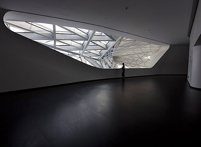 """Via kateoplis :      Zaha Hadid's  Guangzhou Opera House  has finally opened in China ( video )      Beautifully shot video, with overwhelmingly positive remarks about the opera house from The Guardian's architecture critic, Jonathan Glancey, including this gem: """"It's one of the most remarkable buildings not just in China, but in the whole world."""""""
