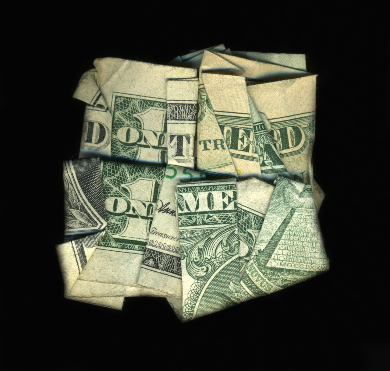 Via  wnyc :     Dan Tague  folds dollar bills up  to make them say stuff. There's an  exhibit of his work  in NYC this week.   — Jody Avirgan