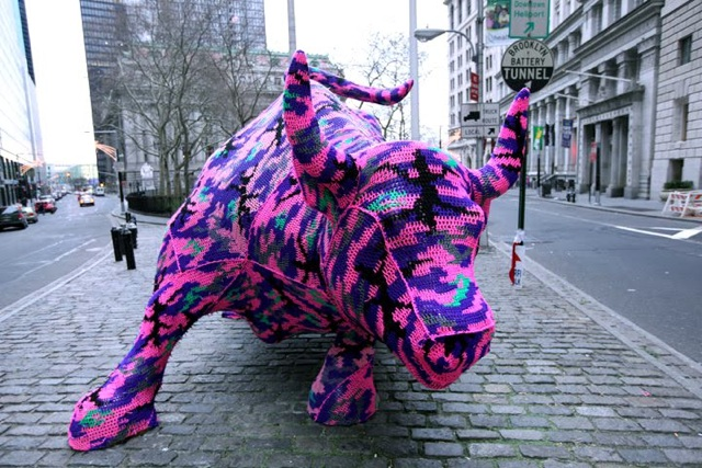Via laughingsquid: Charging Bull on Wall Street Receives Custom Crocheted Outfit Per Gothamist, artist Agata Olek's yarn work, installed on December 26, was removed within two hours (sadly). Wouldn't this have been great to see surrounded by snow?