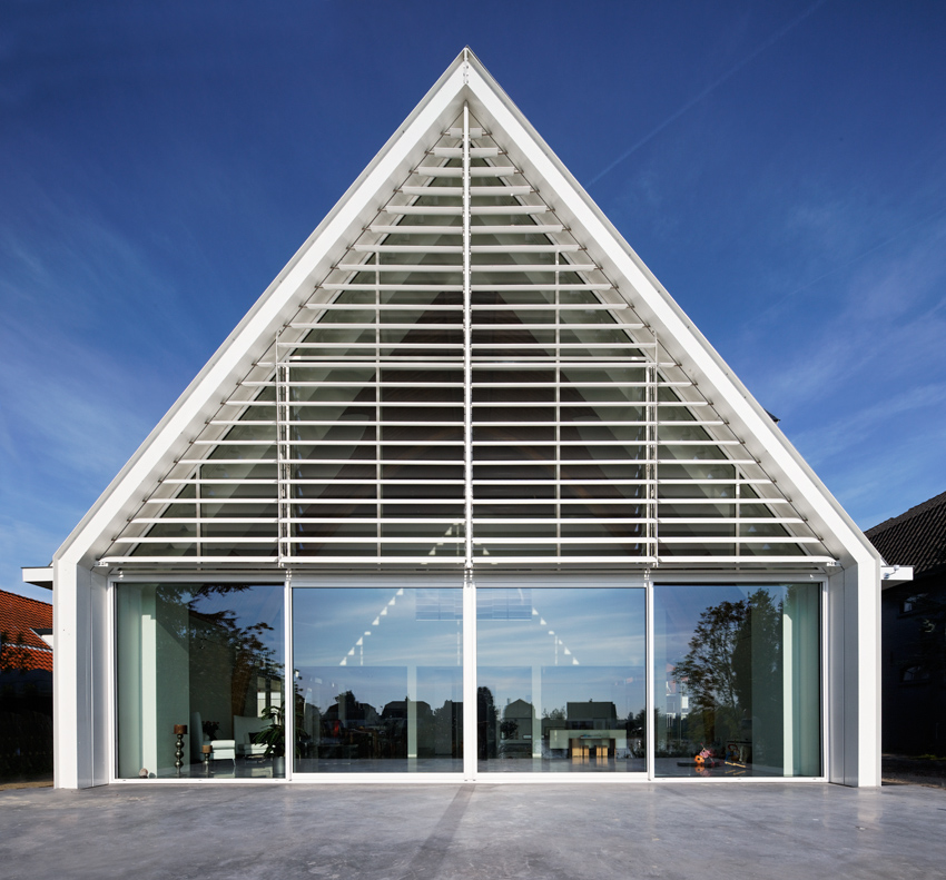 Via architizer: A house carved out of a former church in Rotterdam, Netherlands. The wood-framed church was built in 1930; it had fallen into a disrepair and was converted into a mechanic's garage before a family with two small children hired Ruud Visser to make over the space. More details on Architizer.