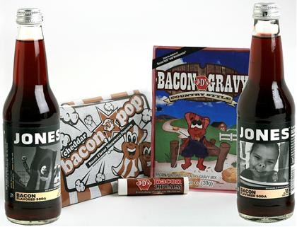 Would you drink bacon-flavored soda?    For those of you with bacon interests:  Jones Soda 's offering this new concoction, launched yesterday, in a special   package  (only $9.99!): two bottles of soda, bacon salt, bacon gravy mix, bacon popcorn,  and  bacon lip balm.      (via   Pop Candy )