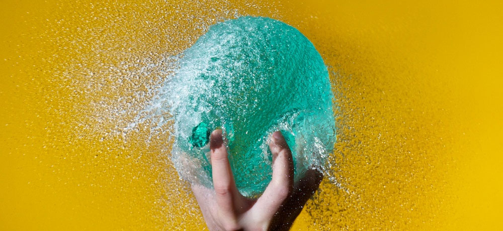Via  nprfreshair :     Edward Horsford's  high-speed photography freezes the spherical innards of water balloons —  just as the balloon skins break open, and just before they splash to  the floor. He works at night in his garden in London, using flashes to  light the action. Amazingly, he works alone.  So how does he do it?  And  doesn't he get soaked?     Amazing.