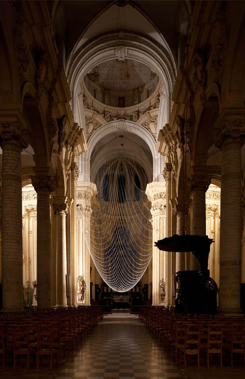 "Via architizer: BLDGBLOG has pictures of ""Upside Dome,"" an installation in the St. Michiel Church in Leuven, Belgium by Gijs Van Vaerenbergh. The project replicates catenary arches to form an 'upside down' dome in the otherwise dome-less cathedral, using only chain hung from the ceiling. BLDGBLOG author Geoff Manaugh says it better than we ever could, writing ""Looking at ""Upside Dome""… is like seeing the underlying geometric logic of Western space bleed through from a hidden dimension."""