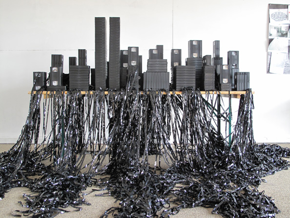 Via  artgalleryofontario :      Mounir Fatmi   Save Manhattan 02 , 2009  VHS tapes, glue, table  Dimensions variable  Courtesy of the artist and Lombard-Freid Projects, New York    Click here to learn more.
