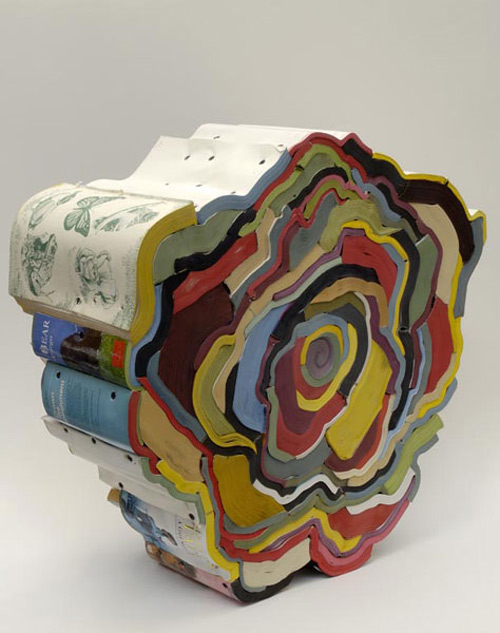 Via  szymon :     magnificent  book sculptures  by Jonathan Callan     Jonathan Callan is another artist who makes good use of discarded books. (And wood screws.)   Take a few minutes to open the link above and scroll through images of his other works. Truly amazing.   Here's an  interview  with Callan (in association with a February 2010 installation in Wisconsin for which area residents gathered some 3,000 books for his use) in which he talks about his work, process.