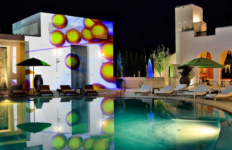 """The third annual 'Digital Graffiti' event – billed as the world's first projection art festival – will illuminate the town of Alys Beach, Florida, tonight. The perfect (white) backdrop:All buildings in Alys Beach, a Duany Plater-Zyberk (DPZ) master-planned town with New Urbanism roots (emphasizing walkability, community, connectedness), are energy-efficient, white stucco-covered masonry with white tile roofs. Event organizer Mike Ragsdale said the festival was inspired by the town's founder, Jason Comer, who challenged his people to create an """"extraordinary"""" annual event that would attract people to Alys Beach, which was founded in 2004. """"My company once wrote video game reviews for Time Warner, and we often tested the games by projecting them onto a huge white wall in our office,"""" said Ragsdale. """"Because the buildings in Alys Beach are white, it occurred to me that our town is like one giant blank canvas. So the notion of fusing together art, architecture and technology eventually evolved into the Digital Graffiti event."""" The event's 36 participating artists, selected from a field of more than 300 applicants, will compete for $10,000 in cash prizes."""