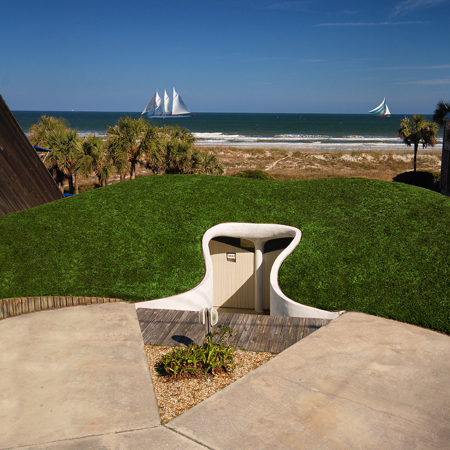 Preservation-worthy: 70s-era beachfront Dune House near Jacksonville is in a hill (and on the market). Unique is an understatement. Click on photo to view slideshow. [Wall Street Journal story: http://bit.ly/2F8A5]