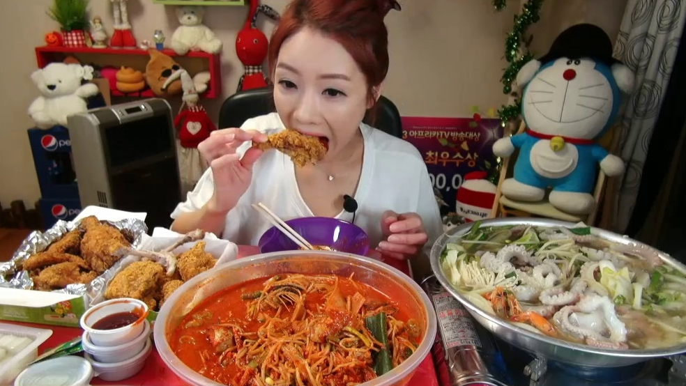 "Park Seo-yeon, also known as ""The Diva,"" used to make around $8000 per month from broadcasting herself eat. Here, she gets ready to chow down dishes fit for 10 people."