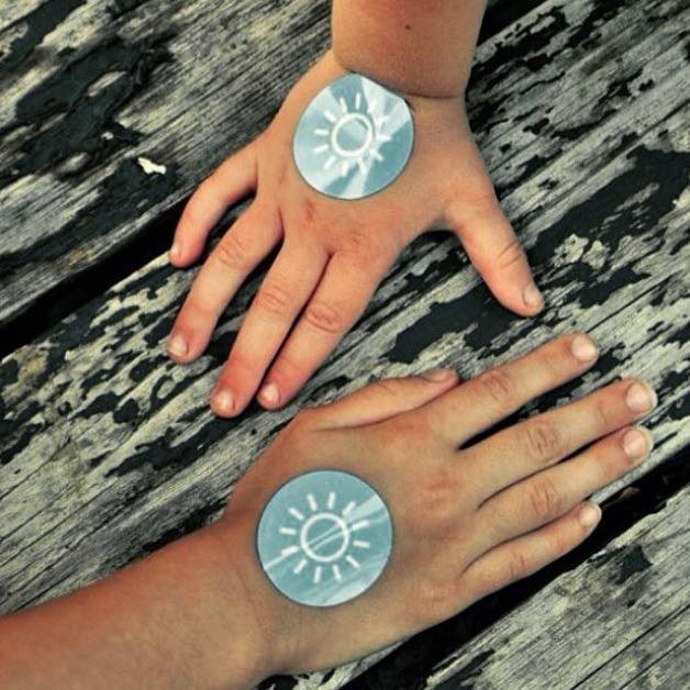 """"""" I have really been enjoying using Sunburn Alert UV Stickers,  they are really so easy.  No guessing, no forgetting, waterproof, and disposable these stickers are perfect for busy afternoons working outside or a day on the beach. I have been using them regularly. My good friend loves using them on her 6 month old, no worries for baby sunburns!"""" – Alicia"""