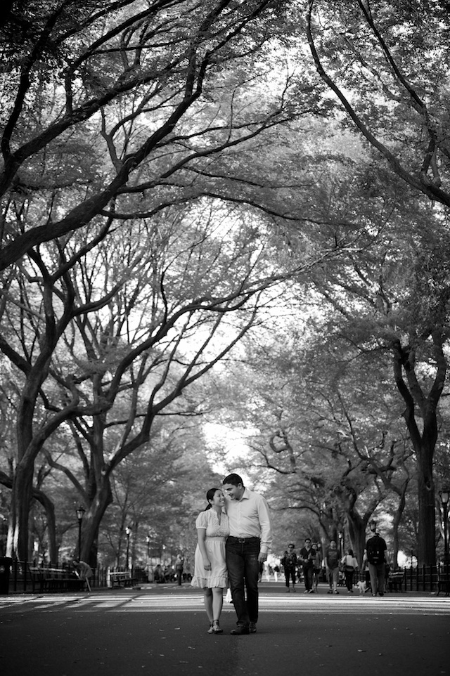 wedding couple walking down path of trees in Central Park