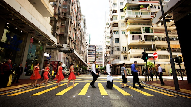 Wedding party crossing street in Causeway Bay