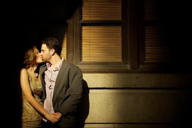 Engagement photo kissing outside Legislative Council Building in Central, HK