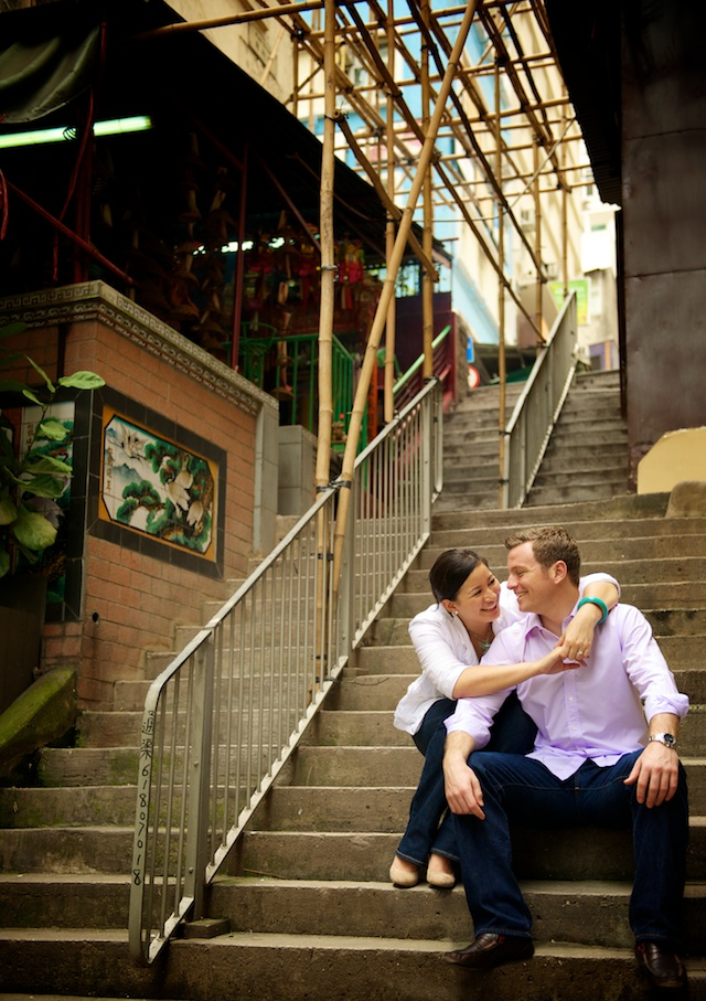 Hong Kong engagement session couple sitting on steps under bamboo scaffolding