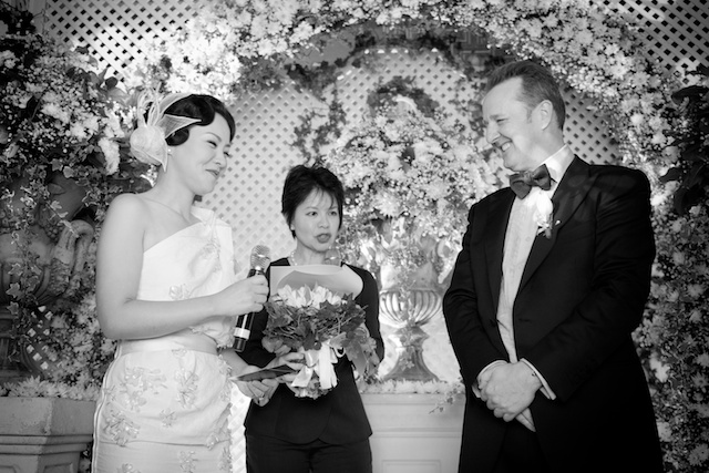 Hong Kong wedding bride groom vows exchange minister alter black white hullett house