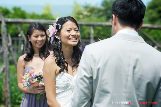 New York wedding outdoor ceremony bride giving vow exchange