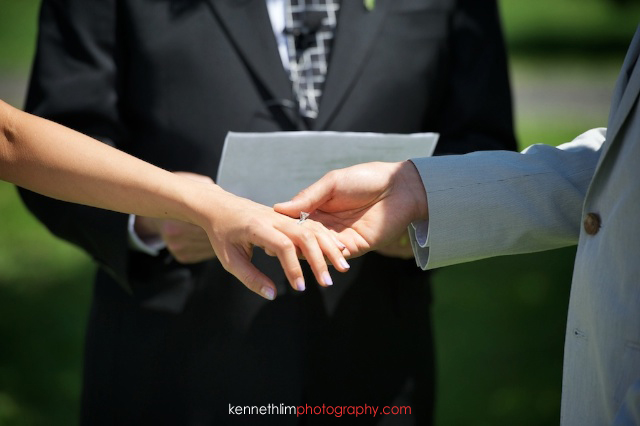 New York wedding outdoor ceremony groom bride giving ring exchange