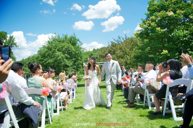 New York wedding outdoor ceremony groom bride walk off