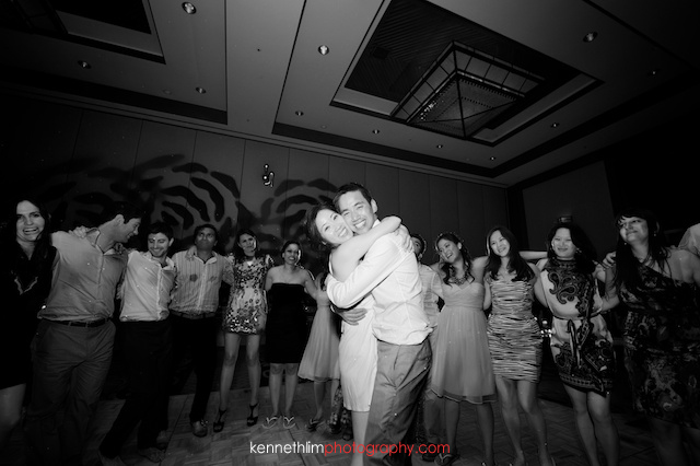 Kona Hawaii US Wedding bride groom dancing friends hugging circle black and white