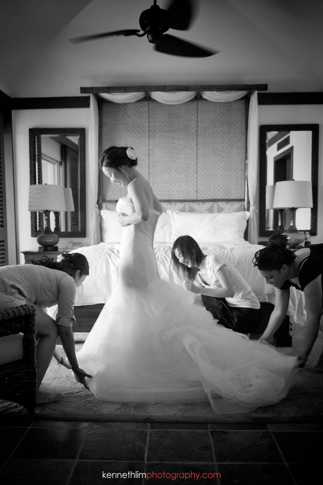 Kona Hawaii US Wedding outdoor bride putting on gown dressing getting ready