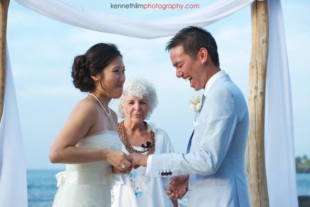 Kona Hawaii US Wedding outdoor ceremony bride groom ring exchange