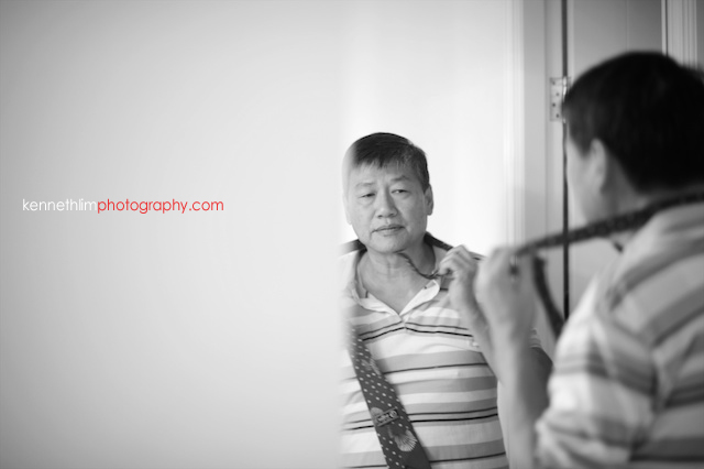 Hong Kong The Verandah wedding morning father of bride getting ready mirror tie