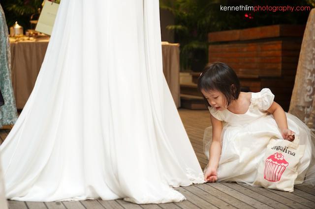Hong Kong The Peninsula wedding girl playing with wedding dress