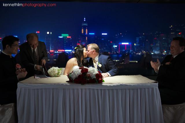 Hong Kong The Peninsula wedding groom and bride first kiss