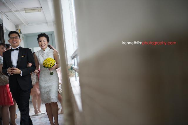 Hong Kong wedding morning groom bride walking down corridor laughing