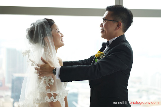 Hong Kong Wooloomooloo Prime wedding groom lifts brides veil