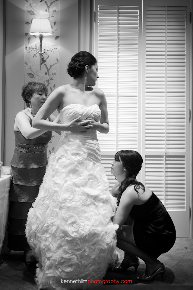 Hong Kong Country Club wedding bride getting ready putting dress on
