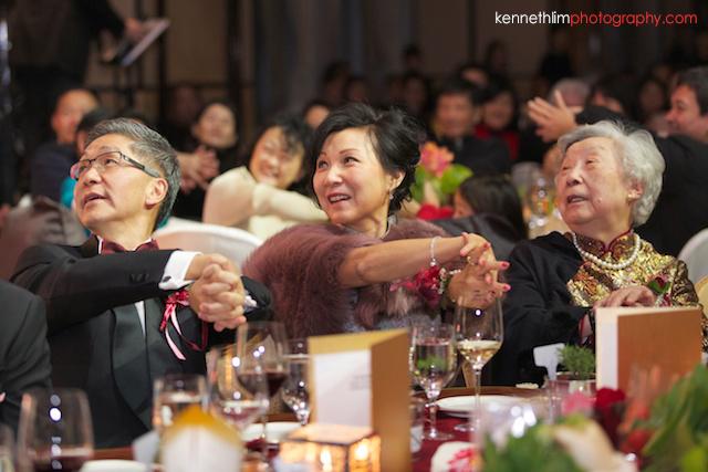 Hong Kong wedding Four Seasons banquet guests magic trick demonstration