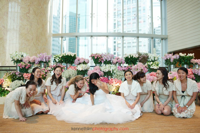 Hong Kong wedding Four Seasons reception portrait session bride with bridesmaids laughing
